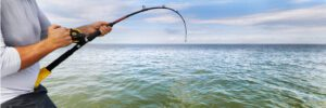 baitcaster rod and reel combo kayak - catching fish on baitcaster