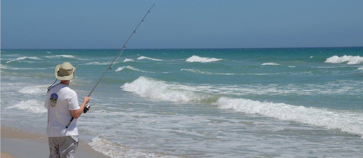 what do i need to start fishing - man on beach