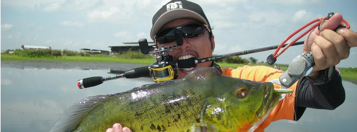 Baitcaster combos for bass fishing - man with bass