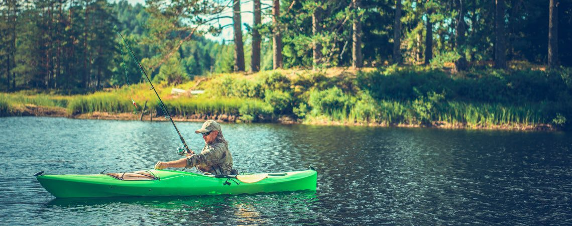 Best Sit In Fishing Kayaks - man in sit in kayak