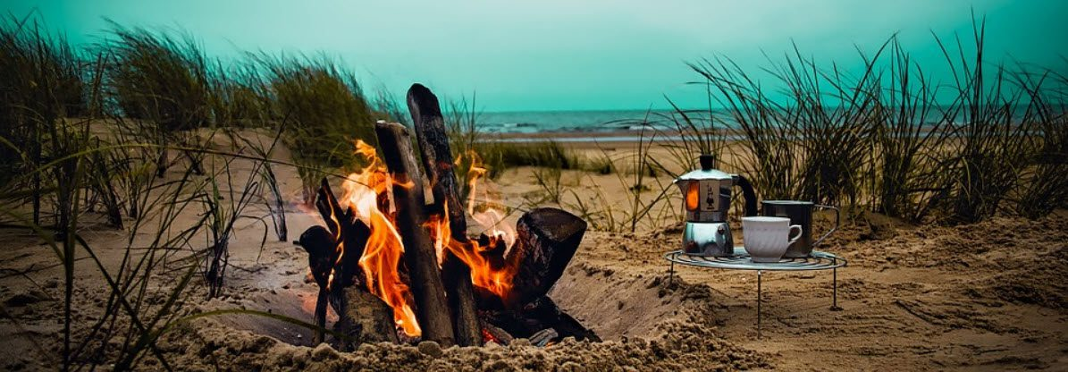 beach camping tips - fire in dunes