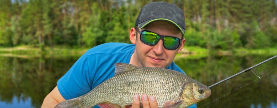 best fishing sunglasses - man with fish