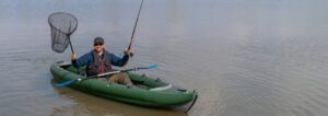 best inflatable fishing kayaks - man in with rod in kayak