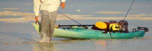 high end fishing kayaks - man with kayak