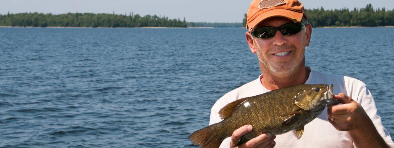 smallmouth bass fishing tips - man with smallmouth bass