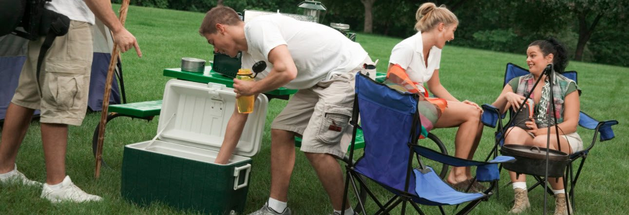 Best Camping Coolers - man reaching into cooler