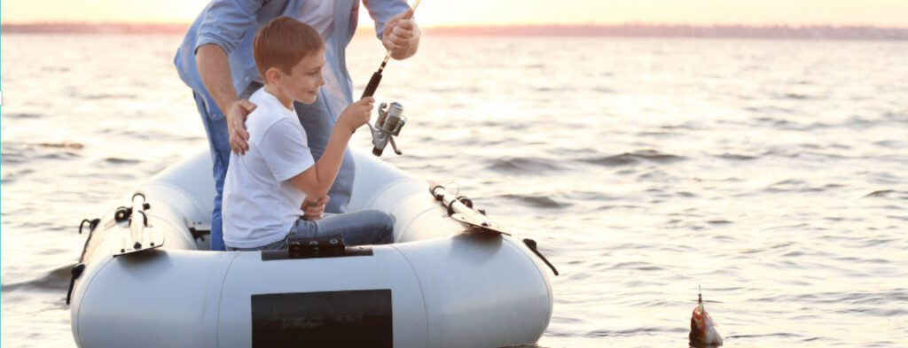 Best inflatable fishing boats - kid fishing in inflatable boat