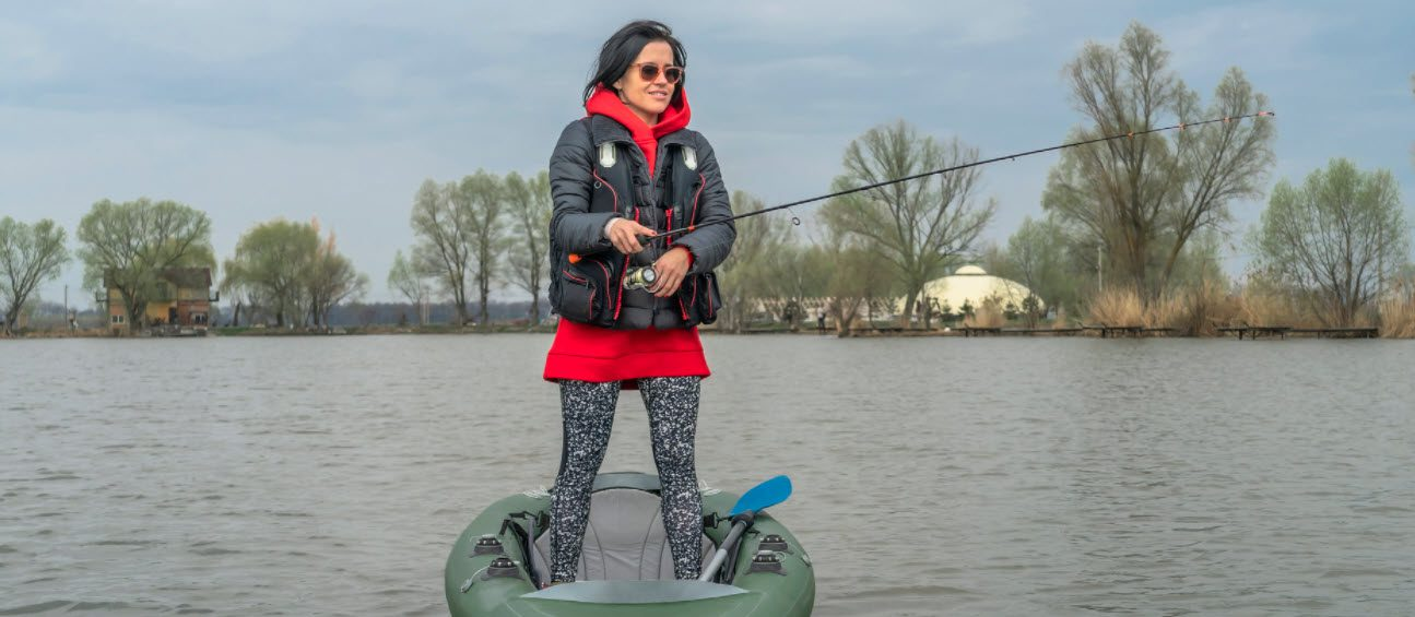 How To Stay Safe When Fishing On A Kayak - woman standing on kayak