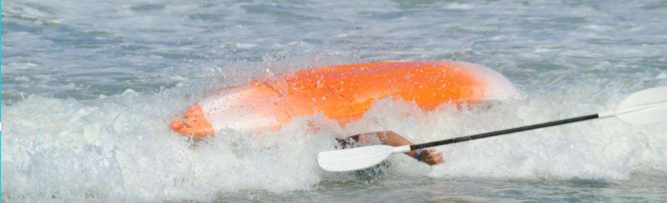 Stop A Fishing Kayak From Capsizing - tipping kayak in surf