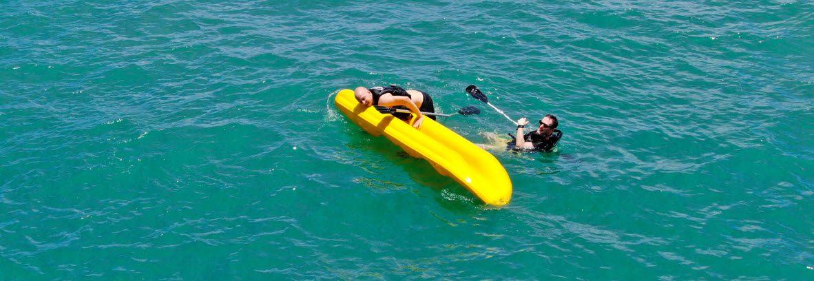 Stop A Fishing Kayak From Capsizing - two men on tipped kayak