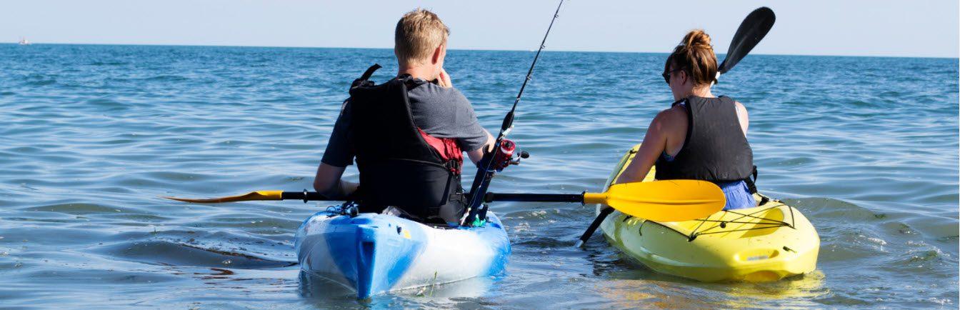 high end spinning reels kayaks - couple in kayaks