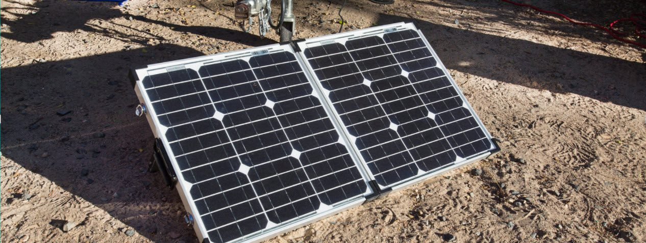 Best Portable Solar Panels for Camping - Solar panels in dirt
