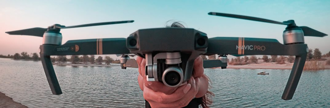 how to surf fish with a drone - girl holding drone