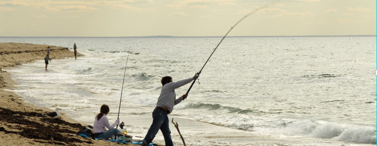increase casting distance in surf - man casting on beach