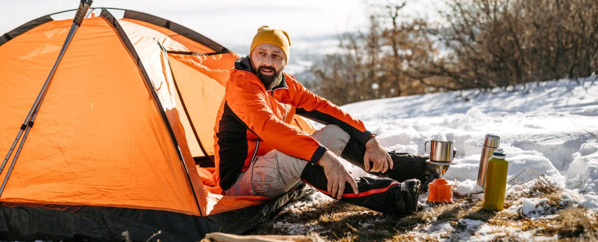 tips for winter camping - man in tent