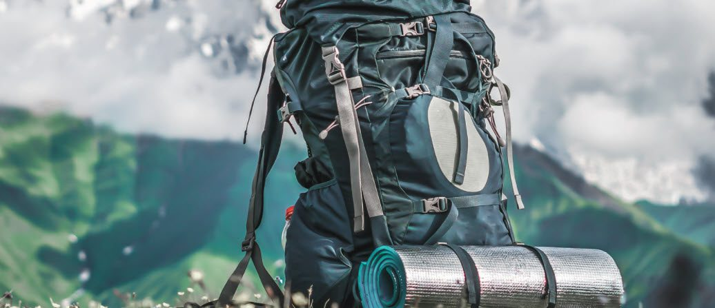 Camping Sleeping Pad - rolled up pad on backpack