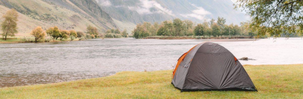best lightweight tents - tent beside stream